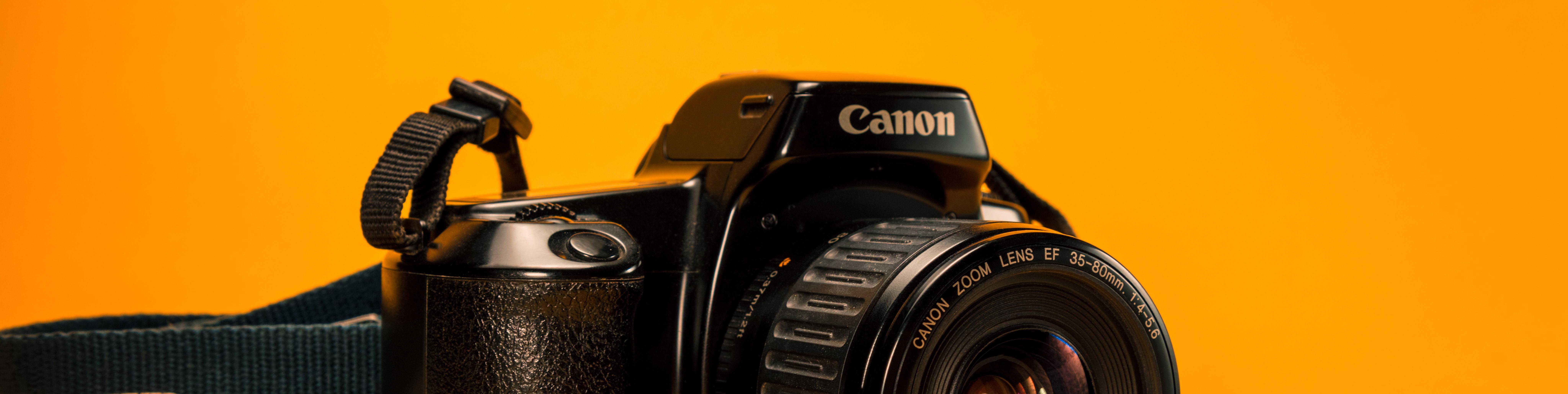 Canon camera on bright orange background