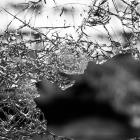 A close-up shot of glass broken and cracked