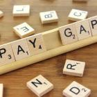 "Scrabble letters spelling out ""Pay Gap"""